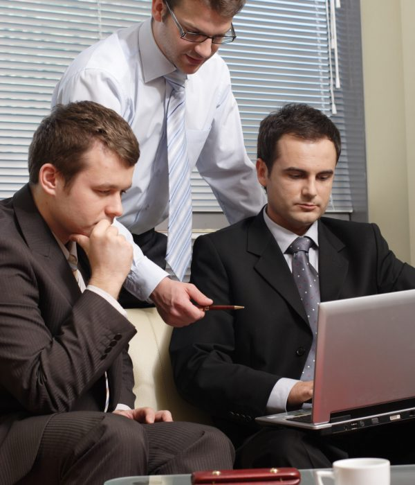 Young Business Men Working With Latop In Office